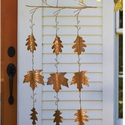 Ancient Graffiti - Spinning Leaves 9 Leaves - Maple and oak leaves that hang from a branch and move in the wind. Attractive and light-catching verdigris/copper antique finish. Hook included.