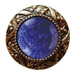 "Inviting Home - Victorian Knob (24K gold plate with blue sodalite) - Victorian Knob in 24K gold plate with blue sodalite semi-precious stone 1-3/8"" diameter Product Specification: Made in the USA. Fine-art foundry hand-pours and hand finished hardware knobs and pulls using Old World methods. Lifetime guaranteed against flaws in craftsmanship. Exceptional clarity of details and depth of relief. All knobs and pulls are hand cast from solid fine pewter or solid bronze. The term antique refers to special methods of treating metal so there is contrast between relief and recessed areas. Knobs and Pulls are lacquered to protect the finish.  Blue Sodalite Semi-Precious stone. Blue Sodalite is a royal blue colored stone that usually has some white or gray-colored streaks. Blue Sodalite looks a bit more crystal-like. It was named by Professor Thomas Thompson who was called in to identify the specimen that was brought from Greenland to Denmark during the time of the Napoleonic wars - he identified it at first as Sodium Aluminum Silicate Chloride. The stone is associated with the Astrological sign Sagittarius and is thought to promote focus clearing mediation and calming of fears. Victorian Jewel pulls and knobs will allow you to have so much fun with the design. The pulls and knobs come in five different kinds of semi-precious stones: Black Onyx Tiger Eye Blue Sodalite Red Carnelian and Green Aventurine. You can even use all of the different colors of the semi-precious stones on one cabinet facade which would give it an eclectic and playful look."