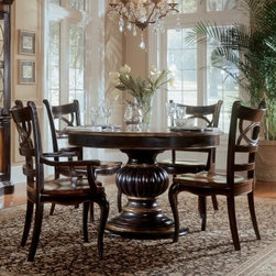 Hooker Furniture Preston Ridge 7 piece Pedestal Dining Set with Oval Back Chairs - More original than round, and more fun than rectangular, the Preston Ridge 7 pc. Pedestal Dining Set with Oval Back Chairs gives a little bit of the unexpected to the traditional design. The heavy, ornately carved pedestal base is sure to stop guests in their tracks, while the contrasting cherry rub-through finished top provides the pizzazz of a little contrast. A brilliantly executed, glossy black finish completes the rest of the table, from the solid apron to the base of the pedestal.This long-lasting set is constructed from hardwood solids with cherry and mahogany veneers. It features an extendable leaf and comes with two arm chairs and four side chairs, all done in the same beautiful finish and complete with oval back detailing. This set is durable and timeless enough to become a beloved family heirloom.Not available for sale in, or delivery to, the state of California.About Hooker Furniture CorporationFor 83 years, Hooker Furniture Corporation has produced high-quality, innovative home furnishings that seamlessly combine function and elegance. Today, Hooker is one of the nation's premier manufacturers and importers of furniture and seeks to enrich the lives of customers with beautiful, trouble-free home furnishings. The Martinsville, Virginia, based company specializes in lifestyle driven furnishings like entertainment centers, home office furniture, accent tables, and chairs.Construction of Hooker FurnitureHooker Furniture chooses solid woods and select wood veneers over wood frames to construct their high-quality pieces. By using wood veneer, pieces can be given a decorative look that can't be achieved with the use of solid wood alone. The veneers add beautiful accents of color and design to the pieces, and are placed over engineered wood product for strength. All Hooker wood veneers are made from renewable resources and are located primarily on the flat surfaces of the furniture, such as the case tops and sides.Each Hooker furniture piece is finished using up to 30 different steps, including 13 steps of hand-sanding and accenting. Physical distressing is done by hand. Pieces receive two to three coats of solid lacquer to create extra depth and add durability to the finish. Each case frame is assembled using strong mortise-and-tenon joints, which are then reinforced by mechanical fasteners and glue. On most designs, end panels extend to the floor to add strength and stability. Panel-style furniture features strong panel and frame construction to help avoid warping.Your Hooker furniture features finished case interiors to eliminate unsightly raw wood and to help protect items you may store inside drawers or cabinets. Drawer parts are given a urethane or lacquer finish to create smooth action and durability. All drawers use dovetails, either English or French, for years of problem-free use. Drawer bottoms are constructed from plywood and attached to the plywood drawer sides via the use of hot glue and/or wood glue blocks. Most drawers are full width, depth, and height to provide the maximum amount of storage space.