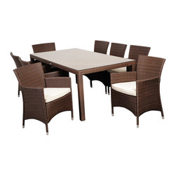 Atlantic - Grand Liberty Deluxe 9 Piece Brown Rectangular Dining Set - Enjoy time with friends and family outdoors with this nine-piece dining set designed for use on the patio or deck. This contemporary set is made of weather-resistant wicker, and the treated cushions repel water, so it can be left out all year long.