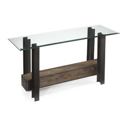 Magnussen Furniture - Rowan Rectangular Sofa Table - Contructed from Hardwood Solids, Metal wheels and glass. All pieces feature 10mm tempered glass top. All pieces feature rivet-set distressed metal I-beams. Contemporary styling. Aged Chestnut Finish. Hardwood Solids, metal wheels and tempered glass. Aged Chestnut Finish. 1 Year Limited Warranty. 50 in. W x 18 in. D x 28 in. H (73 lbs.)The conversation just got more interesting. Our striking Rowan group combines rustic barn wood, oxidized metal and carriage style wheels for maximum industrial effect. In an eclectic mix of Aged Chestnut, tempered glass and rivet-set, distressed metal I-beams.
