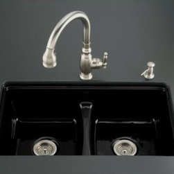 "Kohler - Kohler K-5838-7U-7 Black Black Deerfield Deerfield Undermount Cast - Product Features:  Double basin sink with a 50/50 split provides increased versatility for any task Covered under Kohler s lifetime limited warranty to not chip, crack, or burn The Deerfield Collection bridges the gap between form and function The large basins allow you to keep clean and dirty dishes separate, while providing ample room for oversized pots and pans Constructed of enameled cast-iron which combines strength, durability and insulation benefits Under-mount installation - makes cleaning up around the sink quick and easy Center drain location provides optimal drainage capability All hardware needed for installation included  Product Technologies / Benefits:  Enameled Cast-Iron:  Kohler Enameled Cast-Iron combines the strength, durability, and insulation benefits of cast-iron with the scratch, chip, and burn resistance of a baked, powder coat finish and comes with an exceptional Lifetime Limited Warranty. When these materials are combined it gives the sink or tub the strength to last a lifetime of use. Kohler Enameled Cast-Iron is also available in a wide variety of specialty colors allowing you to truly customize your home. Smart Divide:  The basin divider is set to a lower height than perimeter of the sink; you gain the convenience of a single basin sink completely filled, without losing the functionality of a double basin sink. The lower divider also gives more room for working with larger pots and pans providing more access for filling and cleaning.  Product Specifications:  Height: 9-5/8"" (measured from the bottom of the sink to the top most point of the sink) Overall Width: 22"" (measured from the back outer rim to the front outer rim) Overall Length: 33"" (measured from the left outer rim to the r"