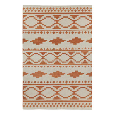 """Tribe rug in Persimmon - """"Indigenous pattern when dissected is almost the exact same throughout the world. When broken down to it's most basic elements, these forms show up everywhere from Uzbekistan to the Great Plains. We wanted to create a pattern that mixed a number of these common shapes to create something new."""" - Genevieve Gorder"""