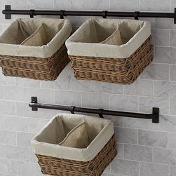 "Hannah Wall Basket Large Storage System with 2 Basket - Our Hannah system provides compact, versatile storage that frees up floor space. The lined, moisture-resistant baskets hold everything from toiletries to washcloths, and the bar can be used on its own to hold towels. Bar: 37"" long x 2"" deep x 3"" high Bar made of iron with a matte rustic finish. Bar is rust resistant. Bar can double as a towel rack. Bar holds ups to two baskets. Bar hook slips into the weave of the basket. Wicker basket includes removable polyester liner. View our {{link path='pages/popups/fb-bath.html' class='popup' width='480' height='300'}}Furniture Brochure{{/link}}. Internet only."