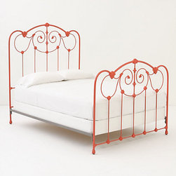 Lydia Bed - It's not often you see an orange bed frame. This one is really whimsical and sweet. It has that garden gate style, but it's modern with the color. It would look sweet in a girl's bedroom.