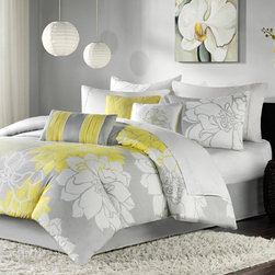 Madison Park - Madison Park Lola Brianna 7 Piece Print Comforter Set - MP10-435 - Shop for Bedding Sets from Hayneedle.com! Finish your bedroom with the Madison Park Lola Brianna 7 Piece Print Comforter Set. Available in a variety of great colors this comforter features an oversized flower design for modern style. It's made of soft cotton and smart polyester which means these covers will give you many cozy nights. Machine-washable and available in a variety of sizes! You get the comforter two pillow shams three decorative pillows and a bed skirt for a complete look. Perfect for the dorm!Comforter Dimensions:Twin: 68 x 90 in.Queen: 90 x 90 in.King: 104 x 92 in.Calif. King: 104 x 92 in.