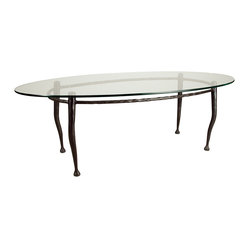 Form & Reform - Pan Coffee Table - If you've been looking for a glass coffee table that has style and clean lines, your search ends here. This oval table is made from hand-forged, hammered metal, with a clear glass top coated with an invisible polyurethane finish.