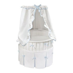Badger Basket White Elite Oval Bassinet with White Waffle & Blue Trim Bedding - With its beautiful traditional styling, white waffle, and blue trim, the Badger Basket White Elite Oval Bassinet with White Waffle & Blue Trim Bedding is a classic and elegant bassinet. Made to hold up to 20 lbs., this bassinet comes complete with a skirt, bumper, fitted sheet, and ruffled drape canopy. The custom fitted foam mattress pad is covered in vinyl and easy to wipe clean when needed. Designed both for beauty and practicality, the canopy is height adjustable and shades the interior from the sun so your baby can rest comfortably in a cool, shaded bed. The caster wheels make it easy to move the bassinet from room to room if needed, however you should never move the bassinet with your baby inside.Blue ribbon ties and grip tape attach the polyester filled bumper to the bassinet and adds a hint of color. Underneath the bumper is a storage shelf which is perfect for keeping small blankets, burp cloths, diapers, and wipes so you have everything readily accessible when needed. Machine washable, the bedding is easy to clean and custom made to fit the White Elite Oval Bassinet. Crafted from wood, wood-composites, and powder-coated steel, the bassinet easily wipes clean with a damp cloth and mild soap. Some assembly is required.Additional FeaturesCanopy shades the interior from the sunCanopy is height adjustableCaster wheels makes moving bassinet simpleBumper attaches with grip tape and ribbon tiesBumper is padded with polyester fillStorage shelf beneath the bassinetBedding set is made from polyester and cottonBedding set is machine washableCrafted from wood and wood-compositesAlso crafted from powder-coated steelEasily wipes clean with damp cloth and mild soapSome assembly requiredBadger Basket CompanyFor over 65 years, Badger Basket Company has been a premier manufacturer of baskets, bassinets, bassinet bedding, changing tables, doll furniture, hampers, toy boxes, and more for infants, babies, and children. Badger Basket Company creates beautiful and comfortable products that are continually updated and refreshed, bringing you exciting new styles and fashions that complement the nostalgic and traditional products in the Badger Basket line.