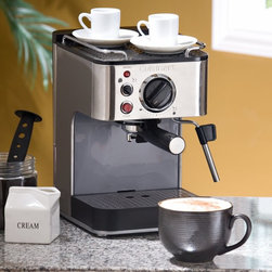 Cuisinart - Cuisinart EM-100 Espresso Maker Dark Brown - EM-100 - Shop for Espresso Machines from Hayneedle.com! Prepare coffeehouse-quality espressos cappuccinos and lattes with the Cuisinart Espresso Maker. This high-quality machine is designed for home use but has all the accoutrements of the professional versions with 15 bars of pressure from a high-quality pump that runs at 1000 watts for the right amount of water pressure. The water tank holds 53 ounces and can be removed for easy cleaning and filling. A stainless steel steam wand removable drip tray and cover and cup-warming surface on top make this machine a must-have for any espresso lover. The Espresso Maker operates with your choice of ground coffee or espresso pods. The portafilter handle has a unique locking mechanism that prevents overspray and makes clean-up a breeze. This unit comes complete with a tamping tool measuring spoon and stainless steel milk-frothing cup. Covered by a three-year manufacturer's warranty. About CuisinartOne of the most recognized names in cookware and kitchen products Cuisinart first became popular when introduced to the public by culinary experts Julia Child and James Beard. In 1973 the Cuisinart food processor revolutionized the way we create fine food and healthy dishes and since that time Cuisinart has continued its path of innovation. Under management by the Conair Corporation since 1989 Cuisinart is a universally celebrated name in kitchens across the globe. With a full-service product line including bakeware blenders coffeemakers cookware countertop appliances kitchen tools and much much more Cuisinart products are preferred by chefs and loved by consumers for durability ease of use superior quality and style.