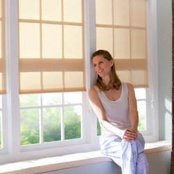 Roller Shade with Cassette Valance - These clean roller shades tuck up into a fabric faced cassette valance for a neat and functional look.