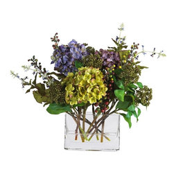 Mixed Hydrangea with Rectangle Vase Silk Flower Arrangement - Bring back memories of earlier days with these lovely traditional hydrangeas. Featuring a mix of cream and pastel colors, this vibrant silk flower arrangement adds a nice touch to any home or office decor. Delicate pom-pom petals surrounded by a variety of green foliage are sure to capture your eye. A classy glass rectangular vase filled with artificial water provides all the care you need to keep this breathtaking beauty in superb shape. Height= 12 in x Width= 11 in x Depth= 9 in