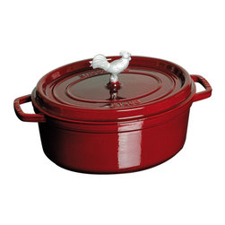 Staub - Staub Coq au Vin Cocotte 4.25 qt. - Grenadine Multicolor - 1122987 - Shop for Dutch Ovens from Hayneedle.com! Conquer French cuisine and more with the Staub Coq au Vin Cocotte 4.25 qt. - Grenadine. Perfect for preparing its namesake dish or other one-pot classics this pan is constructed of cast iron. It features an extra-heavy lid that seals moisture in and dozens of well-placed spikes that continuously baste the pans contents ensuring your dish retains the full flavor of each ingredient. When it's time for clean up simply pop this pan into the dishwasher. The high-quality enamel coating resists scratches and will never discolor.About Staub CookwareFrom professional chefs to home cooks people with a passion for cooking rely on Staub cookware. Combining the utility of cast iron with the latest technology available Francis Staub designed his first enameled pot in 1974 in the Alsace region of France. Known for performance style and durability Staub has become the benchmark for enameled cast-iron cookware. Ideal for braising searing roasting and caramelizing food Staub's signature pots - called cocottes - feature an enameled interior with a matte black finish. Resistant to rust chipping and cracking cocottes are available in round and oval shapes in a variety of sizes and colors. Just right for slow-cooking food Staub cocottes are designed to provide even heat distribution excellent heat retention and continuous self-basting. The inside of each heavy snug-fitting lid features a series of bumps (or self-basting spikes) to allow continuous natural basting by distributing moisture throughout for extra flavor and tenderness. In addition to its signature cookware which is perfect for serving at the table Staub also offers pans for frying sauteing grilling and roasting as well as a variety of teapots accessories and gourmet specialty items.