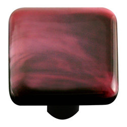 "Aquila Art Glass - Art Glass Square Swirl Knob, Black Post, Dark Cranberry Swirl - To make our cabinet knobs and pulls, 2 to 5 pieces of glass are cut, cleaned, stacked together and placed into a kiln. The kiln goes up to 1450 degrees Fahrenheit, the glass becomes molten and fuses together to make one piece of glass. The glass is then cut out out to the required shape. Next the glass is placed back into a kiln and taken to 1300 degrees fahrenheit and the edges are ""fire polished"". The glass spends about 48 hours in the kilns. Expect slight variations in color & size."