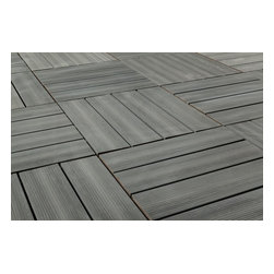 """Kontiki - Kontiki Interlocking Deck Tiles - Composite QuickDeck Series - [10.0 pieces/box] - Driftwood / 12""""x12""""x1"""" -    The striking and multi-tonal nature of real wood in an easily installed composite deck tile is yours in this series on the Kontiki label. This is your way to transform a drab outdoor living surface or a transitioning indoor one in a matter of hours, and do it yourself. For patios, balconies and beyond, creating a stylish space is as easy as can be.    Each composite deck tile is the product of post-consumer and post-industrial manufacturing innovation. The colors and grain patterns are realistic, and are also made to resist the most common types of wear to which any outdoor surface is exposed; fading, scratching, and staining. These are practical outdoor living space surfaces that do not off-gas, do not leech, and are designed to look great for the long-term.     Stylish composite deck tiles you can install yourself _ easily    Making the transition between ��_before��_ and ��_after��_ is very easily done with this series of composite deck tiles. Simply snap them together using a 4-way interlocking system over a stable and flat surface; no special tools, no fuss, right out of the box. When you're done, you'll have a low-maintenance surface that's designed to look great for a long time.    The locking system is raised to allow for maximum drainage during inclement weather, which is one of the keys to their enduring performance. And if you ever decide to re-locate your tiles, that's easy too; it's as easy as installing them. This adds another yet level of re-use and long-lasting surfaces.    Composite deck tiles at best prices    BuildDirect is excited to work with our manufacturing partners who have developed this series of sustainability-minded, highly practical, low-maintenance, and great looking composite deck tiles. Like you, we look for the highest quality in innovative products like this. And we're able to deliver them in innovative ways in o"""