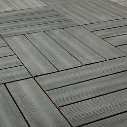 "Kontiki - Kontiki Interlocking Deck Tiles - Composite QuickDeck Series - [10.0 pieces/box] - Driftwood / 12""x12""x1"" -    The striking and multi-tonal nature of real wood in an easily installed composite deck tile is yours in this series on the Kontiki label. This is your way to transform a drab outdoor living surface or a transitioning indoor one in a matter of hours, and do it yourself. For patios, balconies and beyond, creating a stylish space is as easy as can be.    Each composite deck tile is the product of post-consumer and post-industrial manufacturing innovation. The colors and grain patterns are realistic, and are also made to resist the most common types of wear to which any outdoor surface is exposed; fading, scratching, and staining. These are practical outdoor living space surfaces that do not off-gas, do not leech, and are designed to look great for the long-term.     Stylish composite deck tiles you can install yourself _ easily    Making the transition between ��_before��_ and ��_after��_ is very easily done with this series of composite deck tiles. Simply snap them together using a 4-way interlocking system over a stable and flat surface; no special tools, no fuss, right out of the box. When you're done, you'll have a low-maintenance surface that's designed to look great for a long time.    The locking system is raised to allow for maximum drainage during inclement weather, which is one of the keys to their enduring performance. And if you ever decide to re-locate your tiles, that's easy too; it's as easy as installing them. This adds another yet level of re-use and long-lasting surfaces.    Composite deck tiles at best prices    BuildDirect is excited to work with our manufacturing partners who have developed this series of sustainability-minded, highly practical, low-maintenance, and great looking composite deck tiles. Like you, we look for the highest quality in innovative products like this. And we're able to deliver them in innovative ways in order to deliver the greatest p"