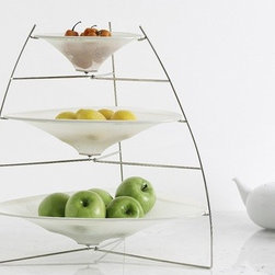 """Chilewich - Three Tier Ray Tray - The innovative use of yarn fuses style and sophistication to create a modern alternative in tabletop dressing. Add another modern touch to your table with the 100% linen napkins and finish them off with classy stainless steel napkin rings! Features: -Tabletop collection.-Metal frame covered with stretch netting.-3-tier tray with basket is an ideal for gently storing fruits and vegetables.-Simple mechanism holds the fabric in a concave plane.-Covers come off easily and are machine washable.-Functions as storage in the kitchen or on a buffet.-Overall dimensions: 19"""" H x 9"""" W at top - 18"""" W at base."""