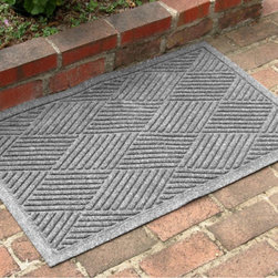 "Grandin Road - Diamonds Mat - The unique ridged construction effectively removes and traps dirt and moisture.. Exclusive, rubber-reinforced face nubs prevent the pile from crushing and extend the mats life.. Other commercial-quality features include anti-static, quick-drying, and fade-resistant properties.. Ultra-slim, 1/4""H pile slips easily beneath most doors. Mat is easily vacuumed or hosed clean. When it comes to blending durability and style, our super-rugged Diamonds Mat is a gem amongst stones. Endures moisture, sun, and even snow, without a care.  .  .  .  .  . Just as impressive placed indoors or out . Crafted to endure from premium polypropylene with a non-skid rubber backing. . Made in the USA."