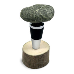 Sea Stones - Stone Bottle Stopper - Hand-gathered from the New England shoreline, these ocean-shaped stones both accentuate and preserve your favorite wines and gourmet oils. Each smooth, ergonomic bottle stopper has a stainless steel body completely immune to wine's acidic qualities and a durable rubber plug that forms an airtight seal to keep contents fresh. Each creation is perched on its own wooden base, transforming the practical topper into a miniature sculpture that adds a touch of natural personality to your table or counter top. Pair with a set of Stone Wine Glasses to create the perfect hostess gift.