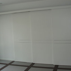 Private residence in Lawrence, NY - Modern style Italian interior 3-door sliding room divider.