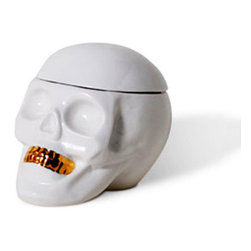 Bling Toothed Skull Jar - Get ready for this flamboyant skull jar with golden shiny teeth and a removable scalp that lets you store your secrets where its brain used to be. Whether as Halloween flair or simply as cool, year-round decor, this Bling Toothed Skull Jar is a fun and funky piece that will give character to your home.