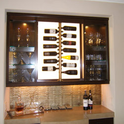 Storage and Access Solutions - Wine Poles!!!  in this case, with a back light with frosted glass panel.