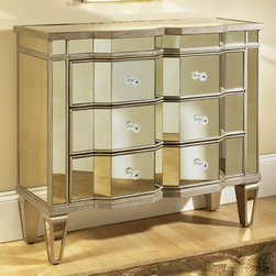 None - Mirrored Three-Drawer Accent Chest - Achieve a glamorous feel with this three-drawer mirrored chest. The frame of the chest is made from hardwood and MDF with a mirror finish. The chest features a mirrored glass top,angled mirror tiles on the drawers,and mirrored arrow feet.