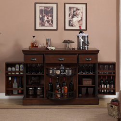 American Heritage - American Heritage Gabriella Bar in Navajo - The Gabriella's simplistic beauty combined with its convenient size make it the perfect functional accent piece for rooms of all shapes, sizes, and schemes. Finished in Navajo with Charcoal Bronze hardware, it provides huge storage benefits in a compact design by utilizing a mesmerizing Lazy Susan-style middle cabinet. Flanked by two other storage cabinets featuring premium piano hinges, the Gabriella can hold the life of the party and more! Three basic storage drawers with clamshell handles provide the finishing touch on this masterpiece.  - 600060NAV.  Product features: Charcoal Bronze Accent Hardware; Lazy Susan Storage Cabinet; Adjustable Shelving; Utility Drawers; High quality piano hinges for long lasting durability; No Assembly Required; Custom select hardwood and veneer. Product includes: Bar (1). Bar in Navajo belongs to Gabriella Collection by American Heritage.