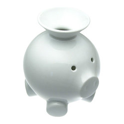 Mint - Coink - Got change? This little piggy will eat it up.  Designed by Scott Henderson, the porcelain piggy bank is both darling and ingenious. Simply empty your pockets into the handy funnel top. Deposits and withdrawals have never been so easy!