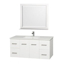 Wyndham - Centra Vanity 48in. in White w/ White Stone Top & Square sink - Simplicity and elegance combine in the perfect lines of the Centra vanity by the Wyndham Collection. If cutting-edge contemporary design is your style then the Centra vanity is for you - modern, chic and built to last a lifetime. Available with green glass, white carrera marble or pure white man-made stone counters, and featuring soft close door hinges and drawer glides, you'll never hear a noisy door again! The Centra comes with porcelain, marble or granite sinks and matching mirrors. Meticulously finished with brushed chrome hardware, the attention to detail on this beautiful vanity is second to none.