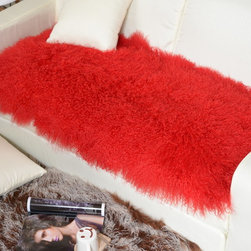 Tibetan / Mongolian Lamb Fur Throw Red - Our luxurious  modern decorative throw is offered in our gorgeous real 100% Tibetan / Mongolian lamb fur and backed with faux suede backing. It adds a touch of softness, beauty, luxury and warmth to any room. All it takes is one accent to invigorate a room with gentle luxury and rich texture. Tibetan lamb fur is a luxurious fur that is incredibly soft, silky and curly. Plus it has natural properties that will keep you cool in the summer and warm in the winter. Fur length is over 4 inches. All colors are professionally dyed.