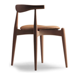 ch20 - Elbow Chair by Hans Wegner - Designed by Hans Wegner in 1956, the simple Elbow Chair encompasses everything this master chair designer was about. It's simple Scandinavian modern lines and ergonomic considerations are just a few of the reasons it sustains its popularity today.