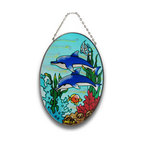 Zeckos - Pair of Dolphins Under Water Oval Glass Suncatcher 9 In. - This colorful sun catcher adds a pretty accent to any window, featuring an underwater scene with dolphins, coral, seaweed, and fish. The coral and seaweed have a crystallized texture, adding some depth to the piece. The sun catcher measures 9 inches tall, 7 inches wide, and has a 2 inch drop from the chrome chain hanger. It makes a great gift for friends and family that is sure to be admired.