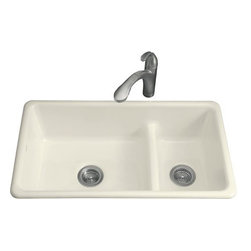 "Kohler - Kohler K-6625-96 Biscuit Iron Tones Iron Tones 33"" Double Basin - Product Features:Double basin sink with a 70/30 split provides increased versatility for any taskCovered under Kohler s limited lifetime warrantyThis Iron/Tones sink offers a simple design that is equally fitting in modern or traditional kitchensThe large/medium basins allow you to keep clean and dirty dishes separate, while providing ample room for oversized pots and pansConstructed of enameled cast-iron which combines strength, durability and insulation benefitsTop-mount or Under-mount installation optionsCenter drain location provides optimal drainage capabilityAll hardware needed for installation includedProduct Technologies / Benefits:Enameled Cast-Iron:  Kohler Enameled Cast-Iron combines the strength, durability, and insulation benefits of cast-iron with the scratch, chip, and burn resistance of a baked, powder coat finish and comes with an exceptional Lifetime Limited Warranty. When these materials are combined it gives the sink or tub the strength to last a lifetime of use. Kohler Enameled Cast-Iron is also available in a wide variety of specialty colors allowing you to truly customize your home.Smart Divide:  The basin divider is set to a lower height than perimeter of the sink; you gain the convenience of a single basin sink completely filled, without losing the functionality of a double basin sink. The lower divider also gives more room for working with larger pots and pans providing more access for filling and cleaning.Product Specifications:Height: 9-5/8"" (measured from the bottom of the sink to the top most point of the sink)Overall Width: 18-3/4"" (measured from the back outer rim to the front outer rim)Overall Length: 33"" (measured from the left outer rim to the right outer rim)Basin Width: 16"" (measured from the back i"
