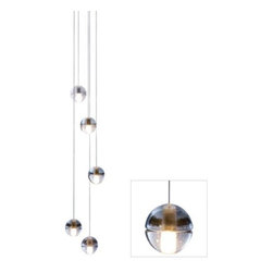Bocci - 14 Series Five LED Pendant Chandelier by Bocci - The Bocci 14 Series Five LED Pendant Chandelier combines traditional hand-crafting with modern energy efficiency. The otherwise perfectly spherical (and seamed) shape of the shades is given distinctive, watery texture via the hand-cast glass process. Natural imperfections in the glass produce a rich halo of light from the inner LEDs.Bocci creates contemporary pendant lighting, chandeliers, sconces and custom lighting, including the award-winning Bocci 14 series. Based in Vancouver, Canada, Bocci fosters a community of designers, craftspeople, technicians, and manufacturers whose goal is to create lighting, furniture and furnish.The Bocci 14 Series Five LED Pendant Chandelier is available with the following:Details:5 Clear cast glass shades with frosted cylindrical voidsBrushed Nickel round ceiling canopyBraided metal coaxial cablesStrain relief hardwareCustom G4 lamp holderEnergy efficientUL ListedDesigned by Omer ArbelLighting: Five 1.5 Watt 12 Volt Low voltage LED lamps (included).Please Note:Strain relief hardware--these cables can be set and reset using an Allan key.Standard cable length is 10 ft. Please call customer service if additional length is need.The Bocci patented custom G4 lamp holder will accept Bocci's proprietary LED technology.Cast glass is an organic process--imperfect by nature--so each piece produced is unique.Each individual pendant is an articulated, seamed cast glass sphere with a frosted cylindrical void, which houses Bocci's proprietary LED lamp.Larger clusters and custom chandeliers are available. Please call customer service for more information.Design Tip: Suitable for residential and commercial use, popular applications to date include clusters over tables, accessory lighting in living rooms, decorative lighting, linear configurations or clusters over bars and kitchen islands, and large chandeliers in building lobbies, restaurants and other public spaces.Shipping:This item usually ships within 1 week.