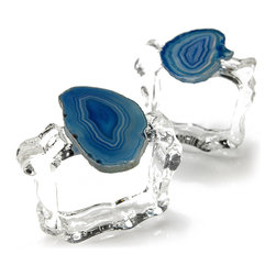 Aleotto Napkin Rings - Azure - Effervescent sparkle in the clear, organically-molded glass used to confine a table napkin contrasts with the more vivid color to be found in a gorgeous slice of deep blue banded agate in these artisan napkin rings.� Made in Brazil from gemstones found amidst the natural treasures of that country, the Aleotto Napkin Rings are authentic one-of-a-kind pieces that set a mood of elegance, glamor, and appreciation for organic luxuries.