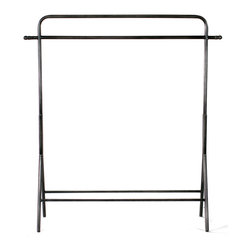 Hastings Garment Rack - Whether vintage is your style of dress or you're simply looking to cleverly show off your favorite ensembles, this antique-nickel finished steel garment rack is a smart solution. With easel legs and a subtly curved contour, it brings classic appeal and functional clothing storage to your space.