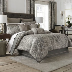 "Croscill Amadeo Comforter Set - Give your bedroom a feeling of cool luxury with the Croscill Amadeo Comforter Set on your bed. The classic look of paisley gets a distinctively contemporary update in shades of gray and white. The chenille cord detail elevates the style of the set, putting it at the top of the style heap. The reversible design is made of durable 100% polyester. Dry clean only. Choose from available sizes.Comforter Dimensions:Queen: 92L x 96W in.King: 96L x 110W in.Calif. king: 96L x 110W in.About CroscillCroscill was started in 1946. This company began with a revolutionary twist on the standard window curtain. Based in Brooklyn, New York, this company was named ""Croscilla"" for the way in which their curtain went across the entire window sill. From the very beginning, Croscill set the highest standards for designs that beautify the home and enrich daily lives. Their design team includes industry leaders who are dedicated to providing a wide array of elegant choices. From timeless classics to the latest trends, you'll find the look you want at Croscill."