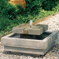 Campania International - Campania International Escala Water Outdoor Fountain - FT-36-NA - Shop for Fountains from Hayneedle.com! The modern design of the tiered Escala Fountain features clean geometric lines perfect for ornamental and Japanese gardens. The water flows smoothly over the first tier into the basin producing a relaxing sound. Available in your choice of finish this fountain is hand-crafted from weather-resistant premium fiber reinforced cast stone concrete and the 6-foot cord plugs into a standard three-prong outlet. The water recirculates within the fountain so no plumbing is necessary. The Escala Fountain is available in the following finishes: natural antique bronze aged limestone alpine stone brownstone copper bronze chandoline English moss greenstone lead antique travertine and verde. Dimensions: 26L x 26W x 15H inches.About Campania InternationalEstablished in 1984 Campania International's reputation has been built on quality original products and service. Originally selling terra cotta planters Campania soon began to research and develop the design and manufacture of cast stone garden planters and ornaments. Campania is also an importer and wholesaler of garden products including polyethylene terra cotta glazed pottery cast iron and fiberglass planters as well as classic garden structures fountains and cast resin statuary.Campania Cast Stone: The ProcessThe creation of Campania's cast stone pieces begins and ends by hand. From the creation of an original design making of a mold pouring the cast stone application of the patina to the final packing of an order the process is both technical and artistic. As many as 30 pairs of hands are involved in the creation of each Campania piece in a labor intensive 15 step process.The process begins either with the creation of an original copyrighted design by Campania's artisans or an antique original. Antique originals will often require some restoration work which is also done in-house by expert craftsmen. Campania's mold making department will then begin a multi-step process to create a production mold which will properly replicate the detail and texture of the original piece. Depending on its size and complexity a mold can take as long as three months to complete. Campania creates in excess of 700 molds per year.After a mold is completed it is moved to the production area where a team individually hand pours the liquid cast stone mixture into the mold and employs special techniques to remove air bubbles. Campania carefully monitors the PSI of every piece. PSI (pounds per square inch) measures the strength of every piece to ensure durability. The PSI of Campania pieces is currently engineered at approximately 7500 for optimum strength. Each piece is air-dried and then de-molded by hand. After an internal quality check pieces are sent to a finishing department where seams are ground and any air holes caused by the pouring process are filled and smoothed. Pieces are then placed on a pallet for stocking in the warehouse.All Campania pieces are produced and stocked in natural cast stone. When a customer's order is placed pieces are pulled and unless a piece is requested in natural cast stone it is finished in a unique patinas. All patinas are applied by hand in a multi-step process; some patinas require three separate color applications. A finisher's skill in applying the patina and wiping away any excess to highlight detail requires not only technical skill but also true artistic sensibility. Every Campania piece becomes a unique and original work of garden art as a result.After the patina is dry the piece is then quality inspected. All pieces of a customer's order are batched and checked for completeness. A two-person packing team will then pack the order by hand into gaylord boxes on pallets. The packing material used is excelsior a natural wood product that has no chemical additives and may be recycled as display material repacking customer orders mulch or even bedding for animals. This exhaustive process ensures that Campania will remain a popular and beloved choice when it comes to garden decor.Please note this product does not ship to Pennsylvania.