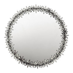 Oly Studio Delanie Round mirror flower detail - This beautiful mirror is glamorous yet a touch whimsical, with star-shaped flowers adorning its frame. It adds reflection, a good feng-shui circle, and metallic shine to any room in your home. I imagine it just about anywhere in the home, from over the mantle to over a console table; in a small powder room or above a dressing table.