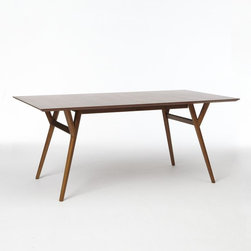Parker Midcentury Expandable Dining Table, Walnut - This dining table is all about form and function. With shapely legs and the ability to expand, it has the best of both worlds: good looks and practicality.