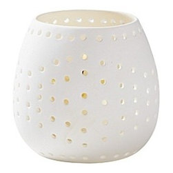 Perforated Votives - Candlelight will dance in this pierced ceramic tea light holder. I'd love one by my bedside. Plus, the simple design is not overtly girly, which will please your guy.