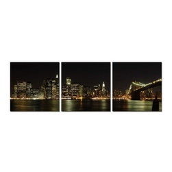 Elementem - NYC Skyline Wall Art | Elementem - Design by Elementem Photography. NYC Skyline is a picture of Manhattan at night with a unique perspective on the great city. With the Brooklyn Bridge on the right, and lower Manhattan on the left, the city lights and their reflection on the East River paint a side of New York's beauty that is often overlooked. An epic view of the iconic city, NYC Skyline will have you thinking you're in the middle of the Big Apple. NYC Skyline is digitally printed on vinyl then mounted onto solid wooden MDF frames and covered with a thin layer of laminate that allows the print to be easily cleaned with Windex and water. All the wall hanging materials needed for installation are provided. Suitable for contract projects. Available in two sizes: 20-In. X 20-In. and 24-In. X 24-In. Special orders can be placed for 28-In. X 28-In. Please contact our Sales Department at (800)236-9100 for more information.Elementem Photography is a proud member of 1 Percent for the Planet, a group of businesses that have committed to donating 1 percent of their sales towards environmental causes.