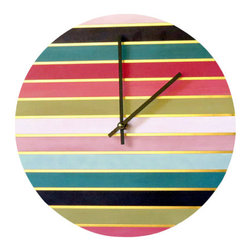 "Rainbow Wall Clock - Add this colorful rainbow and gold striped wall clock to any space for a unique pop of color. This clock is positively glistening with opulence and a measure of allure. Custom handmade from a 12"" vinyl record, it is the perfect harmony of glitz and glamour. The face of this clock features an array of bright colors with thin gold stripes that command attention. This unique wall clock will make a sensual addition to your boudoir or anywhere else you want to make a bold statement. You'll fall in love all over again each time you glance at the time."