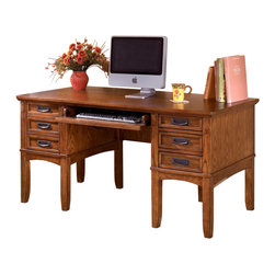 Signature Design by Ashley - Mission Style 7 Drawer Desk - You will be sure to enjoy this attractive desk in your home office to keep clutter at bay while adding style to your current d̩cor. Features a warm oak finish and seven storage drawers to hold your keyboard, papers, and supplies. A wire and Internet outlet keeps cords neat and tidy. Color/Finish: Dark Oak Stain. Traditional mission styling with a medium brown oak stained finish. Constructed with oak veneers and hardwood solids. Modular desk has laptop drawer w/ internet port and electrical outlet. Pull-out keyboard tray is covered with black PVC for durability. Keyboard Tray: 23.5 in. W x 15 in. D x 3.125 in. H. Left Drawer: 10 in. W x 16.25 in. D x 10.125 in. H. Right Middle & Bottom Drawer: 10 in. W x 15.75 in. D x 2.75 in. H. Top Right Drawer: 10 in. W x 15.75 in. D x 2.375 in. H. Overall: 60 in. W x 30 in. L x 30 in. H