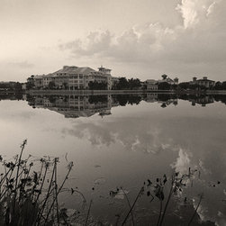 The Andy Moine Company LLC - Sunset Bohemian Hotel Celebration Florida Fine Art Black and White Photography, - Black and White Fine Art Photography captured with 35MM Ilford Film and reproduced in Limited Editions on Brushed Aluminum. This is a beautiful composition of the sunset reflections over Lake Rianhard in the Disney concept village of Celebration, Florida.