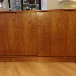"""Mid-Century Modern Credenzas/Dressers/Cabinets - Sliding door teak veneer Danish Modern credenza. Denmark, Early 1970's. Measures 49.25"""" wide, 18.75"""" deep, 29"""" tall. Great condition with very minimal scratching to surface. Has a spot of discoloration on inside of cabinet on the right side. Please see photos."""