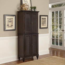 Home Styles - Home Styles Bermuda Espresso Pantry Dark Brown - 5542-69 - Shop for Pantries from Hayneedle.com! With its British colonial meets tropical style and adjustable shelving the Home Styles Bermuda Espresso Pantry is a natural choice for your home. This pantry is made of mahogany solids with mahogany and albazia veneers in a deep espresso finish. Its four shuttered doors hide adjustable shelving. The turned bun feet and antique brass hardware enhance the look.About Home StylesHome Styles is a manufacturer and distributor of RTA (ready to assemble) furniture perfectly suited to today's lifestyles. Blending attractive design with modern functionality their furniture collections span many styles from timeless traditional to cutting-edge contemporary. The great difference between Home Styles and many other RTA furniture manufacturers is that Home Styles pieces feature hardwood construction and quality hardware that stand up to years of use. When shopping for convenient durable items for the home look to Home Styles. You'll appreciate the value.