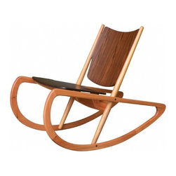 Mäder Designed by Mendes-Hirth - Oh this wonderful rocking chair blows my mind. I would have sworn it was designed sixty years ago, but it was designed by Mendes-Hirth, in 2005. It's a functional work of sculpture that makes the perfect occasional chair in a living room or bedroom.