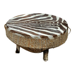 Zebra Skin Drum/Table - Very ethnic and tribal, this zebra skin drum table would look fabulous in a country home as a cocktail table. Obviously, if you like to serve a lot of food on your cocktail table, this is not for you, but you could cover the top with glass to make it more practical. But for a big design bang, this will absolutely do the trick.