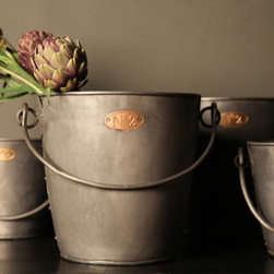 Vintage Champagne Bucket - Inspired by vintage champagne buckets that were once used in grand hotels, these charming pieces feature a rustic finish to captivate any space with classic appeal. Authentic rivets run down the sides and a gold-coated number tag adds an antique touch of old world elegance.